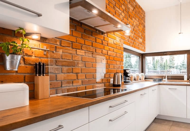 brick wall modern kitchen